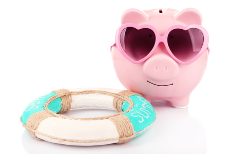 Pink piggy bank in sunglasses with lifebuoy isolated on white Stock fotó