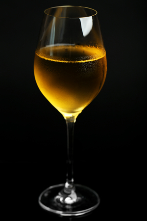 Glass of wine on dark background
