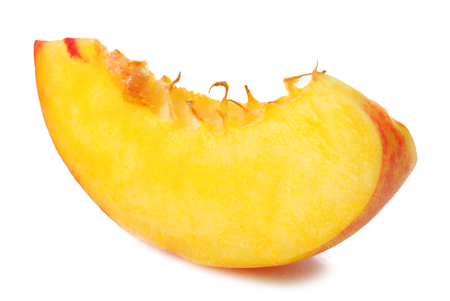 Piece of peach isolated on white