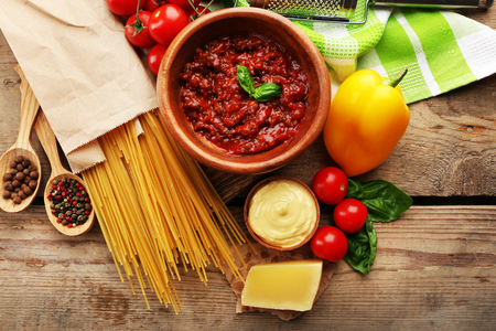 Pasta spaghetti with tomatoes, sauce bolognese, cheese and basil on rustic wooden  background Standard-Bild