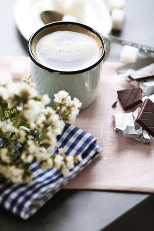 Cup of flavored coffee with chocolate on table with napkin, closeup Archivio Fotografico