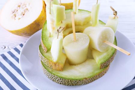 Melon ice lolly on table, closeup