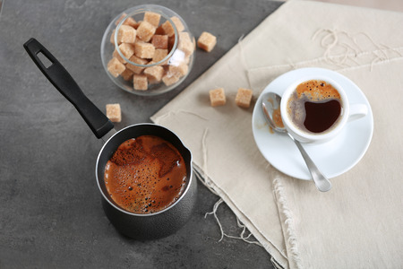Turk of flavored coffee on table with napkin, closeup
