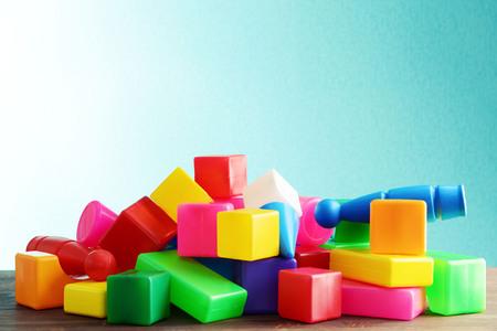 Pile of toys on blue background Stock Photo