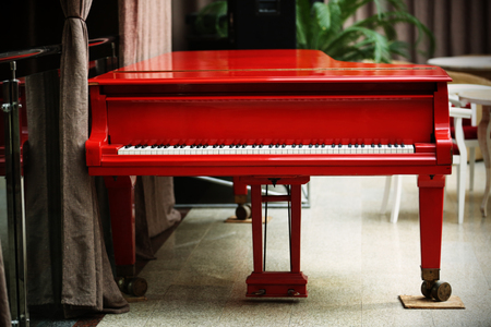 Beautiful red grand piano indoor