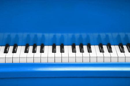 Piano keys of blue piano close up