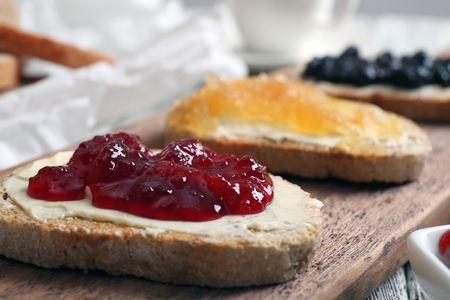 Fresh toast with butter and different jams on table close up 스톡 콘텐츠