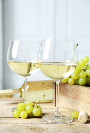 Still life of wine and bread on light background Stock Photo