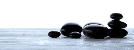 Wet spa stones isolated on white