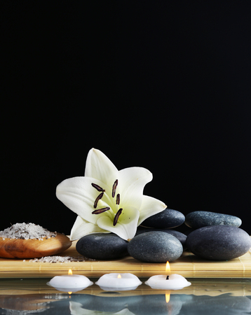 Still life with spa stones on black background Stock Photo