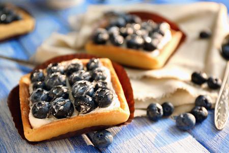 Still life with gourmet fresh blueberry tarts