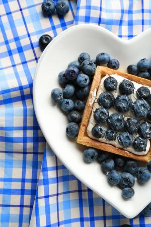 Gourmet fresh blueberry tart on plate, close up