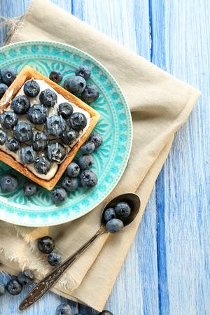 Still life with gourmet fresh blueberry tart  Standard-Bild
