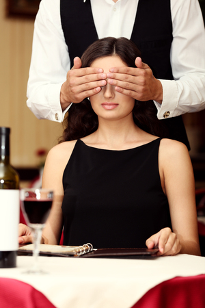 Young attractive woman with closed eyes at the restaurant 写真素材