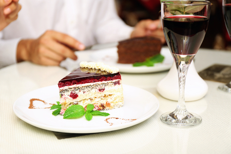 piece of chocolate cake and wine glass