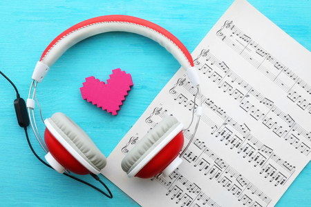 Headphones with musical notes on blue wooden background Stock Photo