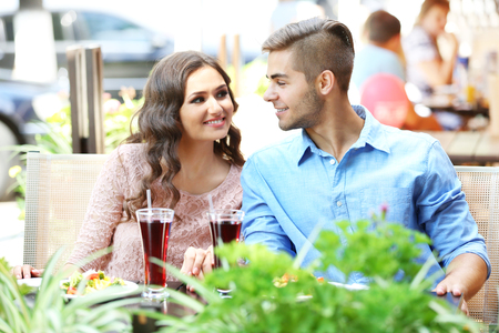 attractive couple have lunch at terrace