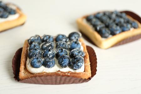 Gourmet fresh blueberry tarts on table Stock Photo