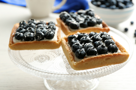 Gourmet fresh blueberry tarts on plate, close up