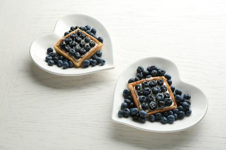 Gourmet fresh blueberry tarts on plates, close up