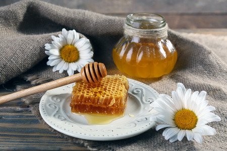 Honey products on wooden table