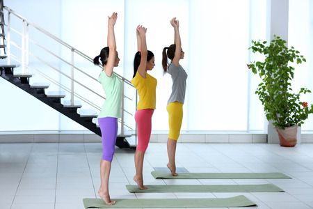 Healthy women do yoga exercises in a gym Stock fotó