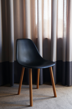 Black modern chair in the room, close up Banco de Imagens
