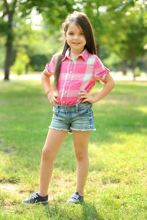 Happy little girl in the park Archivio Fotografico