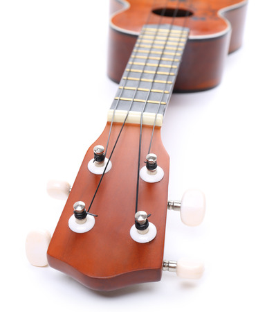 Beautiful Hawaiian acoustic guitar isolated on white