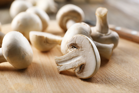 Champignon mushrooms on wooden background 写真素材