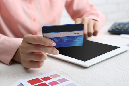 Concept for Internet shopping: hands with digital tablet and credit card Stock Photo