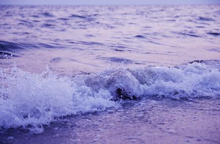 Sea wave on the shore at sunset Archivio Fotografico