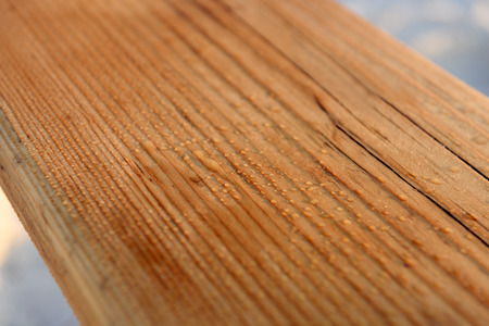 Wooden teeter on the beach, close up Stock Photo
