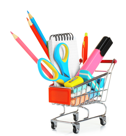 Bright stationery objects in mini supermarket cart isolated on white background 스톡 콘텐츠