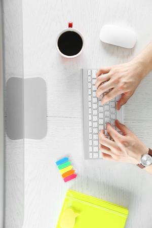 Man working with computer, top view 版權商用圖片