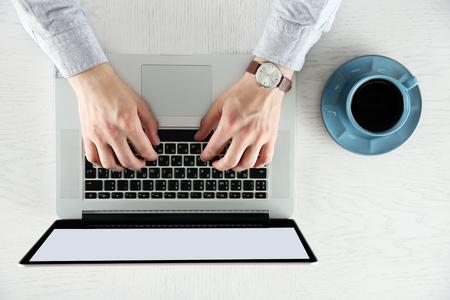 Man working with laptop, top view 版權商用圖片