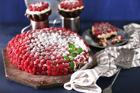 Sweet cake with raspberries on color wooden background 스톡 콘텐츠