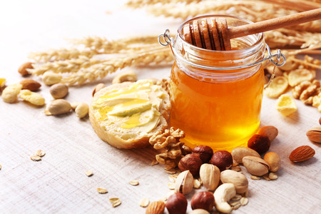 Healthy breakfast with bread, honey, nuts. Country breakfast concept Stock Photo