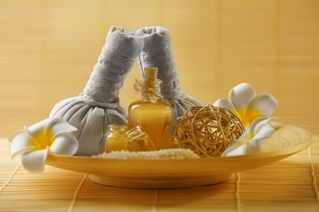 Natural relaxing spa set in a bowl with sea salt on wicker background