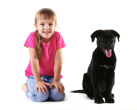 Little cute girl with puppy isolated on white Foto de archivo