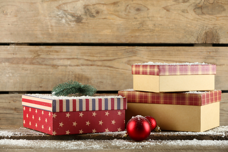 Gift boxes on wooden background Imagens