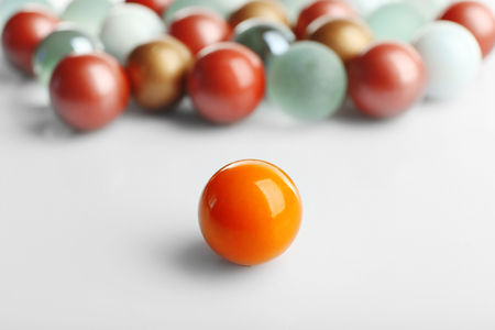 Orange ball opposite others, isolated on white, individuality concept Stock Photo