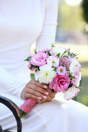 Beautiful wedding bouquet in hands of bride Stock Photo