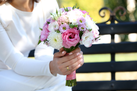 Beautiful wedding bouquet in hands of bride Stock Photo
