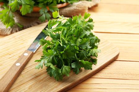 Fresh parsley on wooden cutting board
