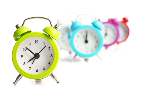 A group of alarm clocks, isolated on white Stok Fotoğraf