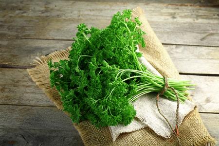 Fresh parsley on sackcloth napkin