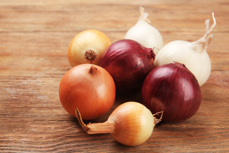 Onion on wooden background Stock Photo