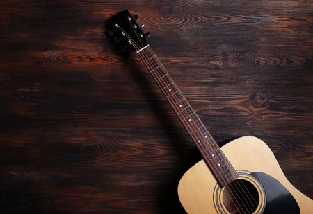 Guitar on wooden background Stock Photo