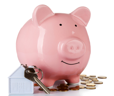 Piggy bank style money box with key isolated on a white Stock Photo